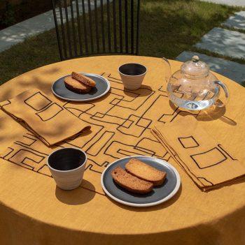 nomad-india-vanya-ochre-black-table-linen-main