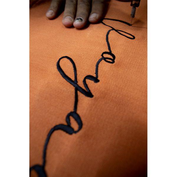 nomad-india-barahmasa-word-cushion-terracotta-voyage-making